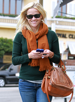 reese witherspoon slammed by peta for python bag